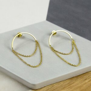 Gold Half Circle Hoops with chain on multi coloured background tile