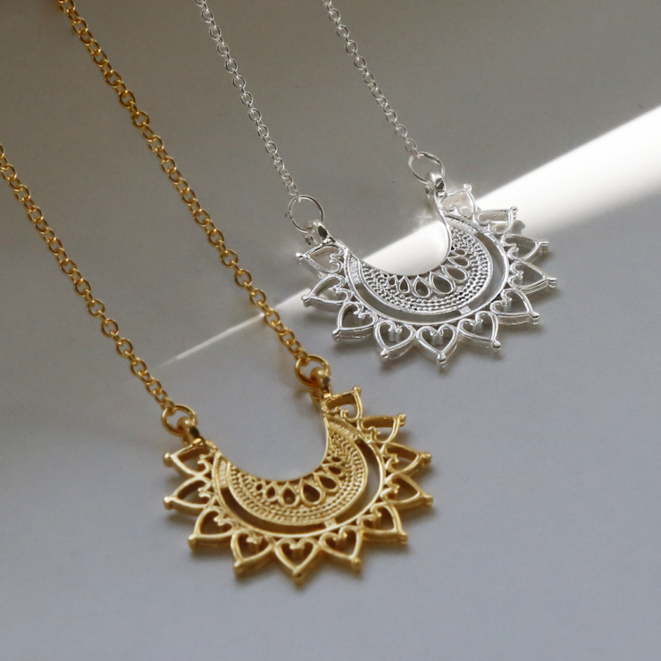 Sterling silver and gold plated sterling silver marrakech affair necklace on white background with crystal.