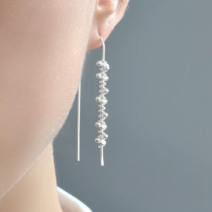 Silver hanging spiral earrings with polished finish