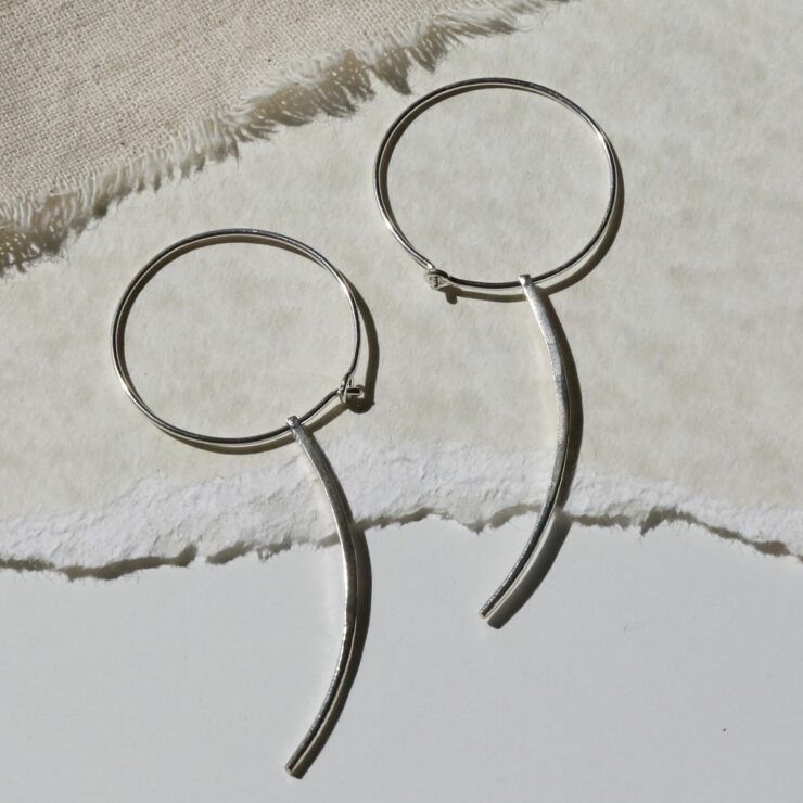Sterling Silver Claw Earring With Claw on canvas background