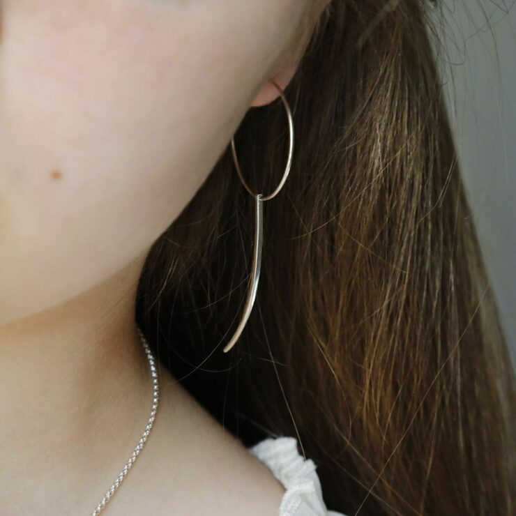 Sterling Silver Claw Earring With Claw on Model with brown hair