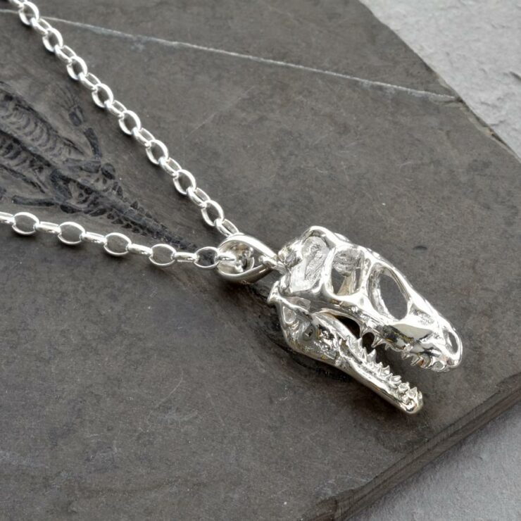 Silver T Rex skull fossil necklace
