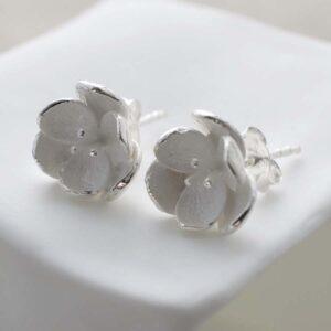 Silver open blossom stud earrings