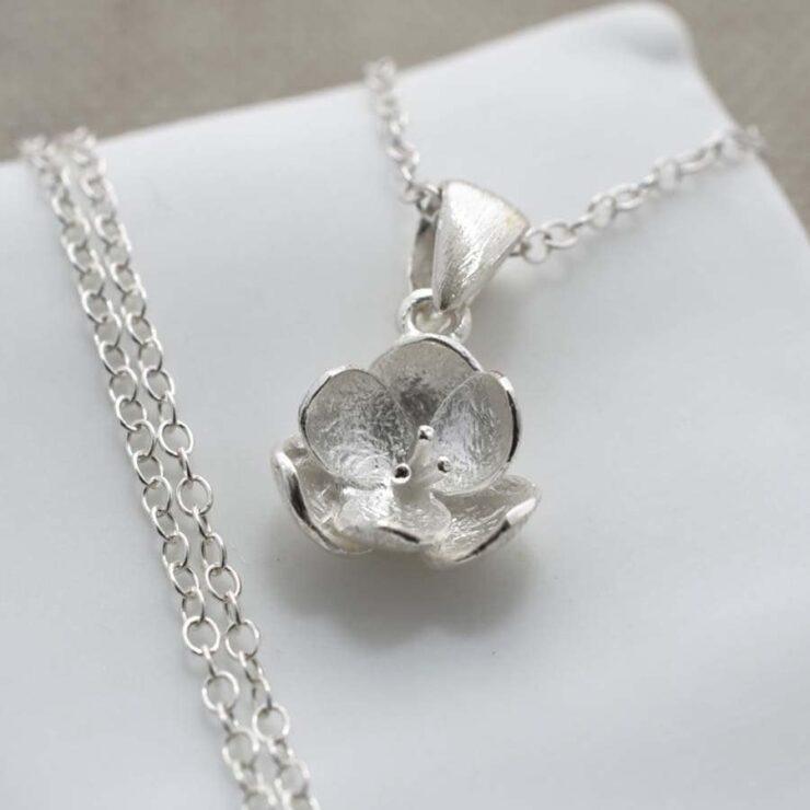 Silver open blossom pendant