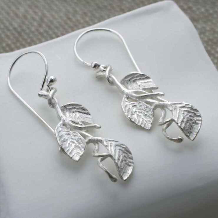 Silver hanging leaves on branch earrings