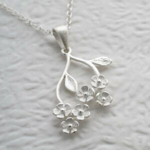 Silver forget me nots hanging from stem pendant necklace