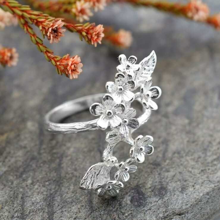 Silver cluster of forget me nots adorned on ring