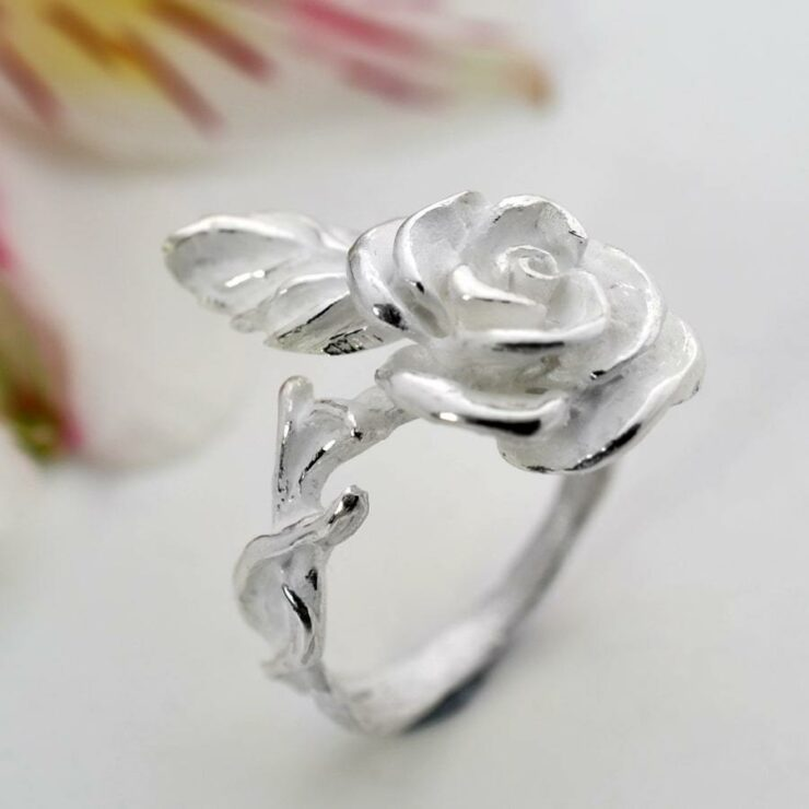 Silver blooming rose adorned on ring