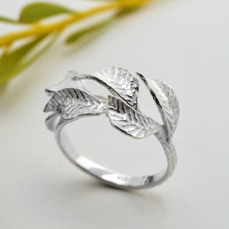 Silver laurel leaves adorned on ring