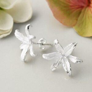 Silver blooming lily flower stud earrings