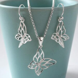 Silver cutout butterfly in flight pendant necklace
