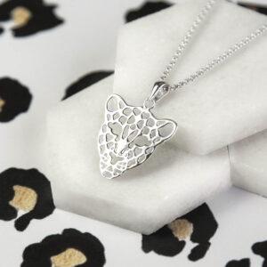 Silver leopard face pendant