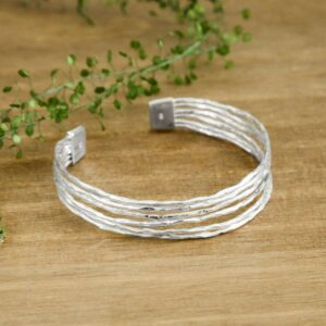 Silver rough textured bangle with clasp