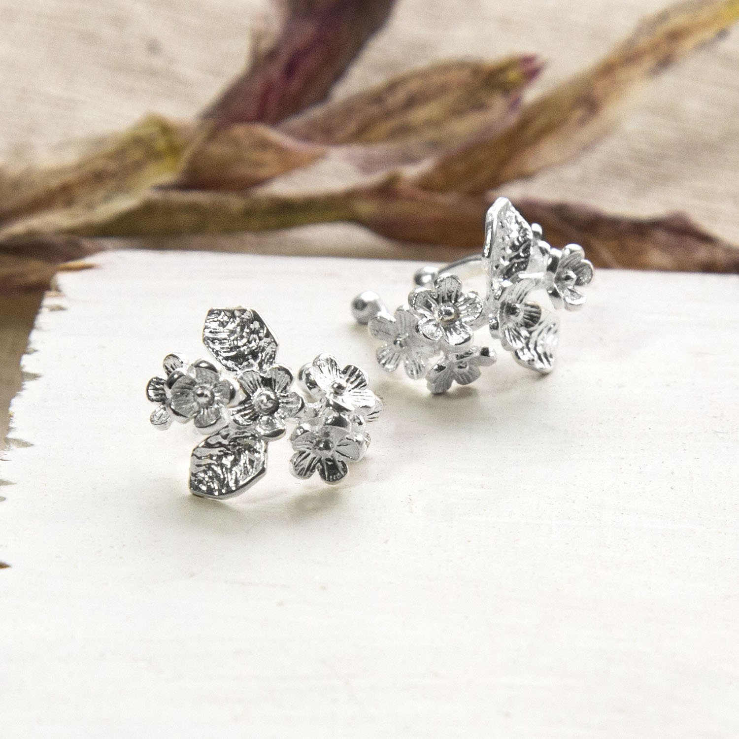 Silver bunches of forget me nots ear cuffs