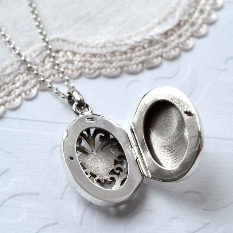 Open silver decorative round vintage locket