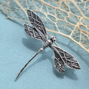 Silver dragonfly in flight brooch