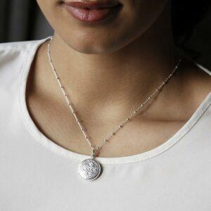 Silver decorative floral round locket