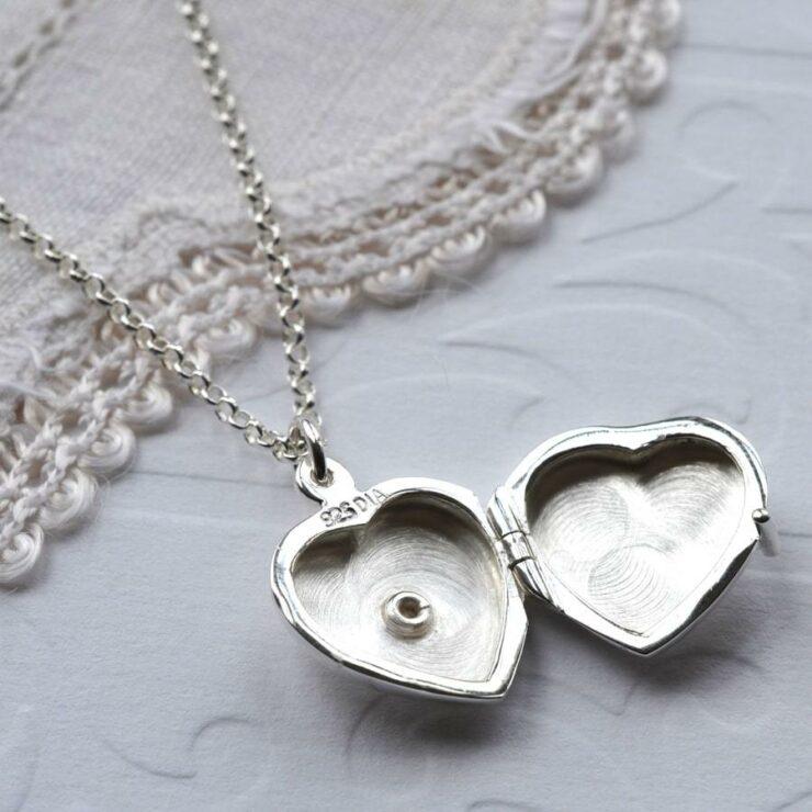 Silver tiny polished heart locket with embedded diamond