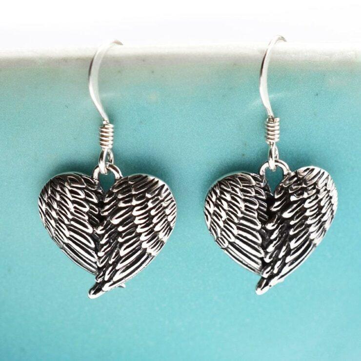Silver heart shaped folded wings earrings