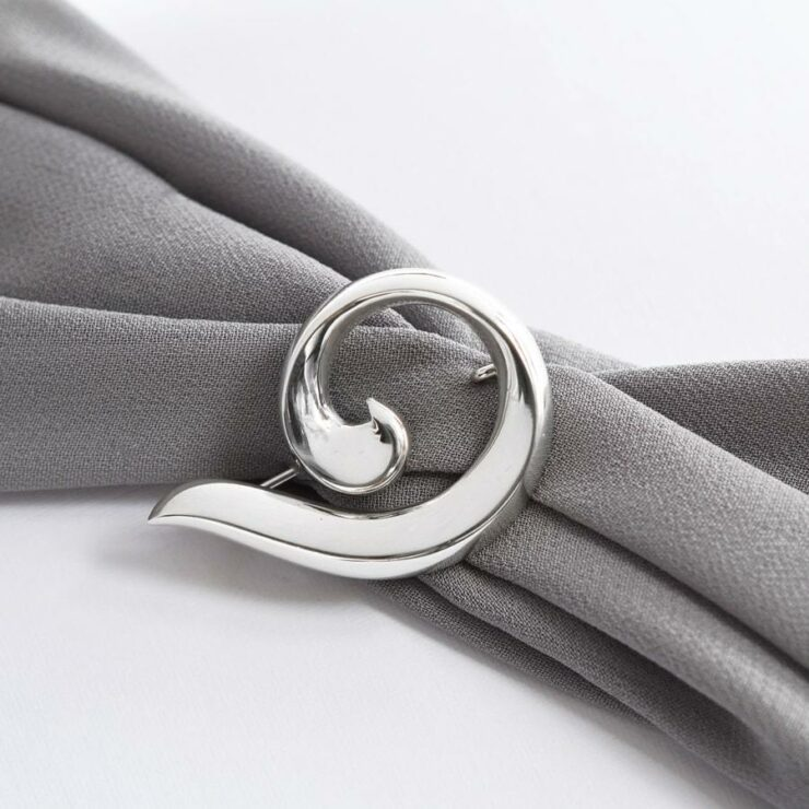 Silver curled ribbon brooch