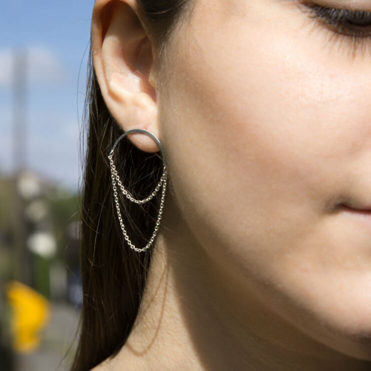 Half circle hoop with chains on brunette model in the sunshine