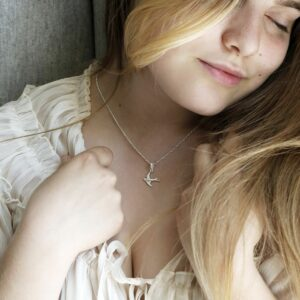 Sterling Silver Swallow Necklace on Model with Blonde Hair