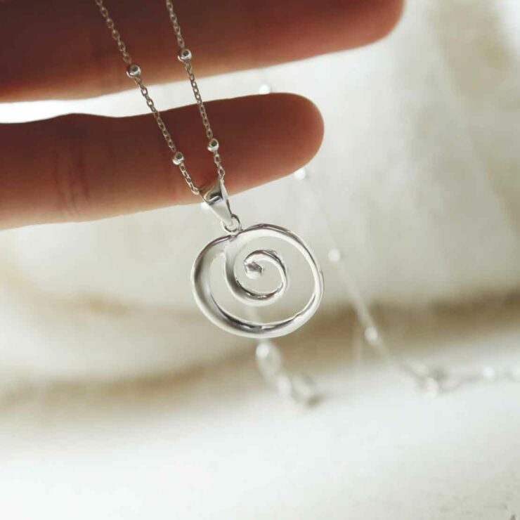Spiral Necklace on Satellite Chain being held