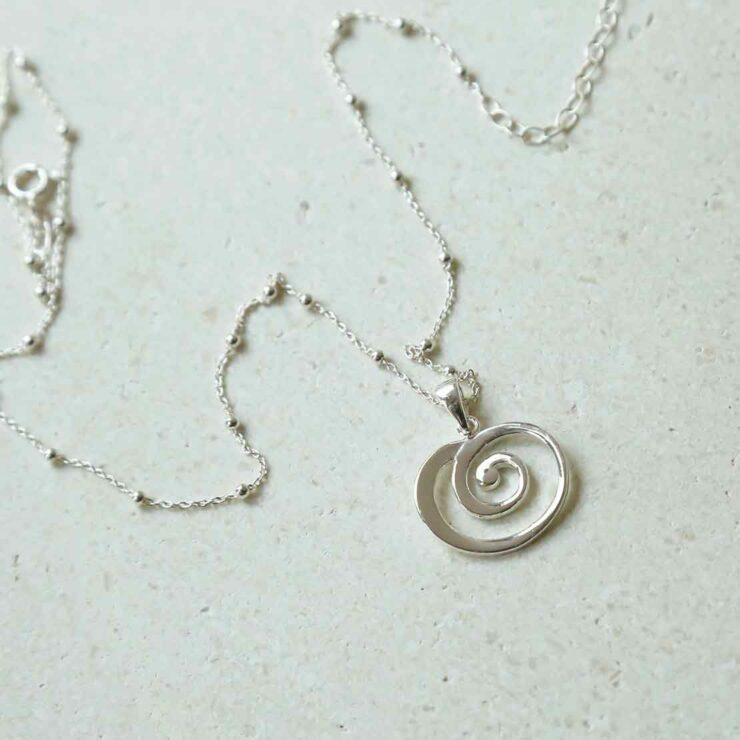 Spiral Necklace on Satellite Chain on white background