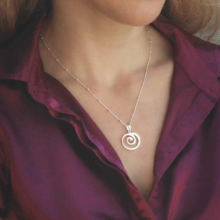 Spiral Necklace on Satellite Chain on model with burgundy shirt