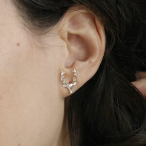 Sterling Silver Stag Stud Earrings on a model