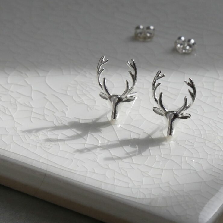 Sterling Silver Stag Stud Earrings on White Background