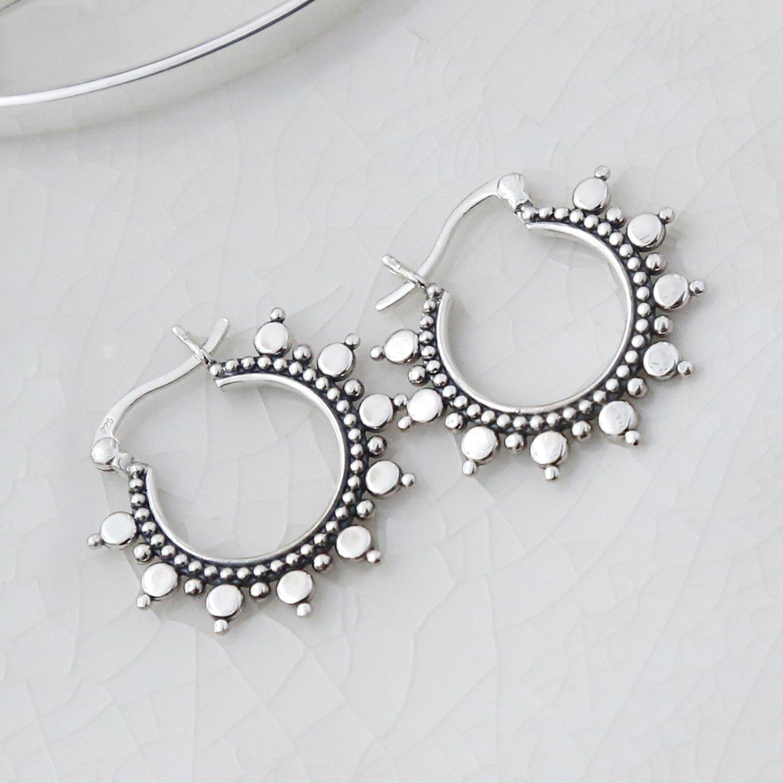 sterling silver karim hoops on white background