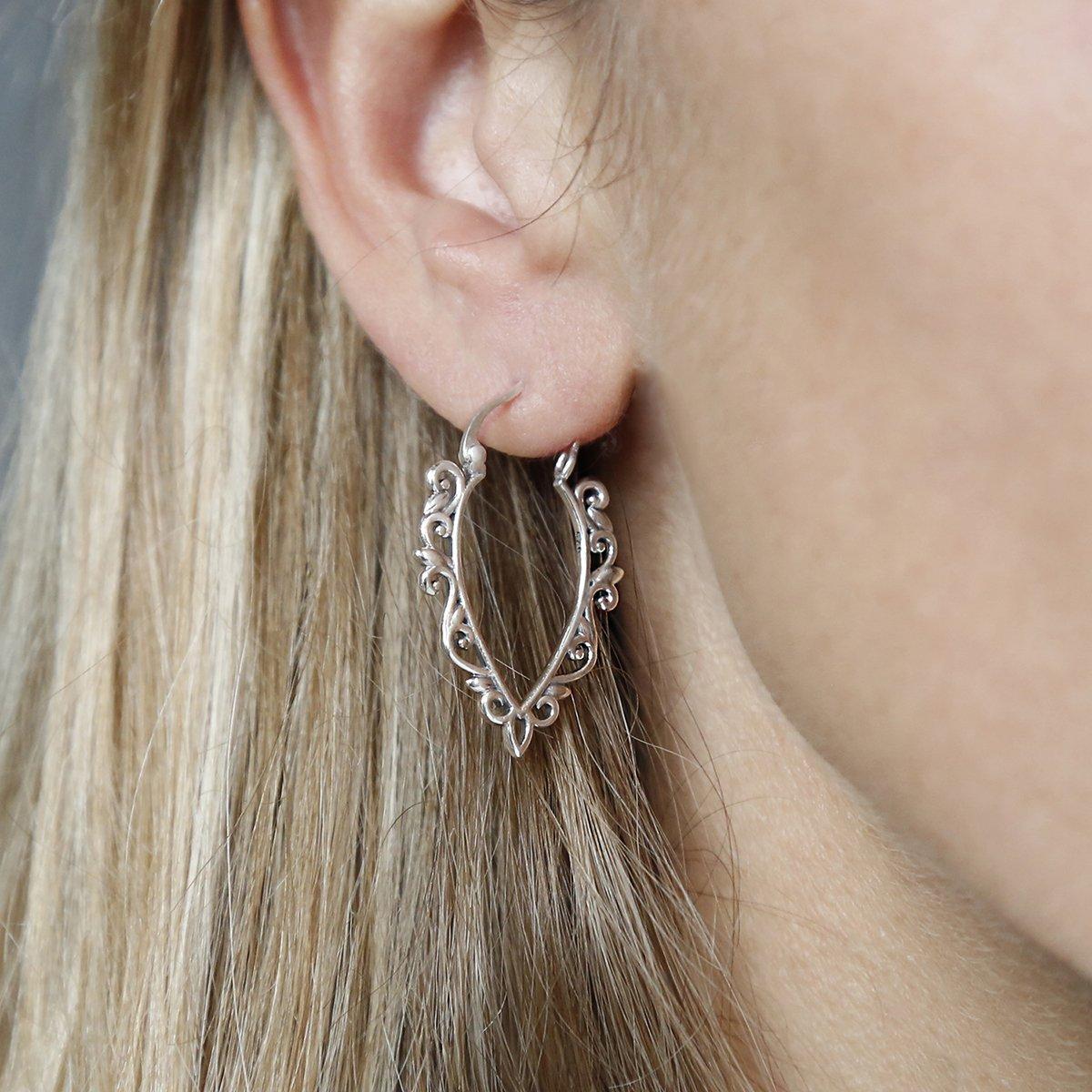 Sterling Silver Harmony Hoops in ear of model