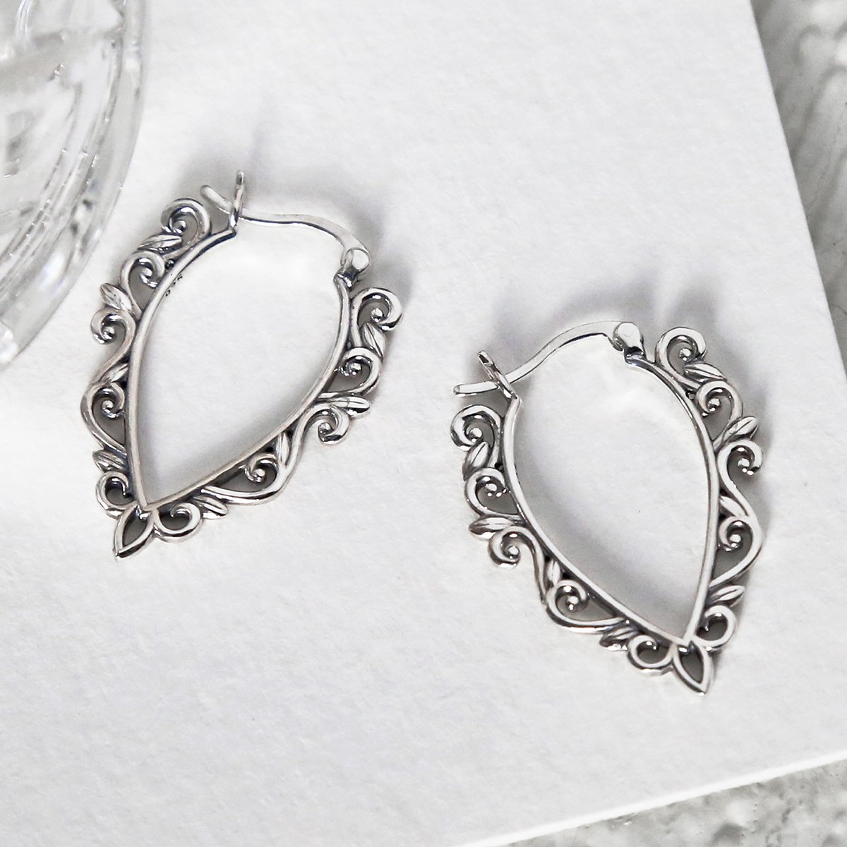 Sterling Silver Harmony Hoops featuring pattern on white background