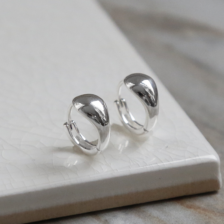 Sterling Silver Chunky Huggies on a white background,
