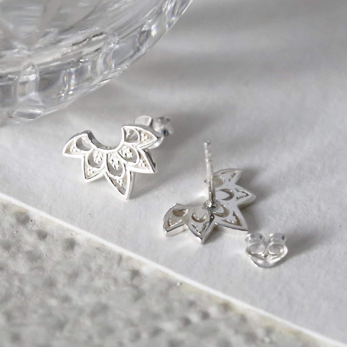 sterling silver eastern starburst studs showing front and back