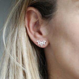 sterling silver eastern starburst studs on model's ear