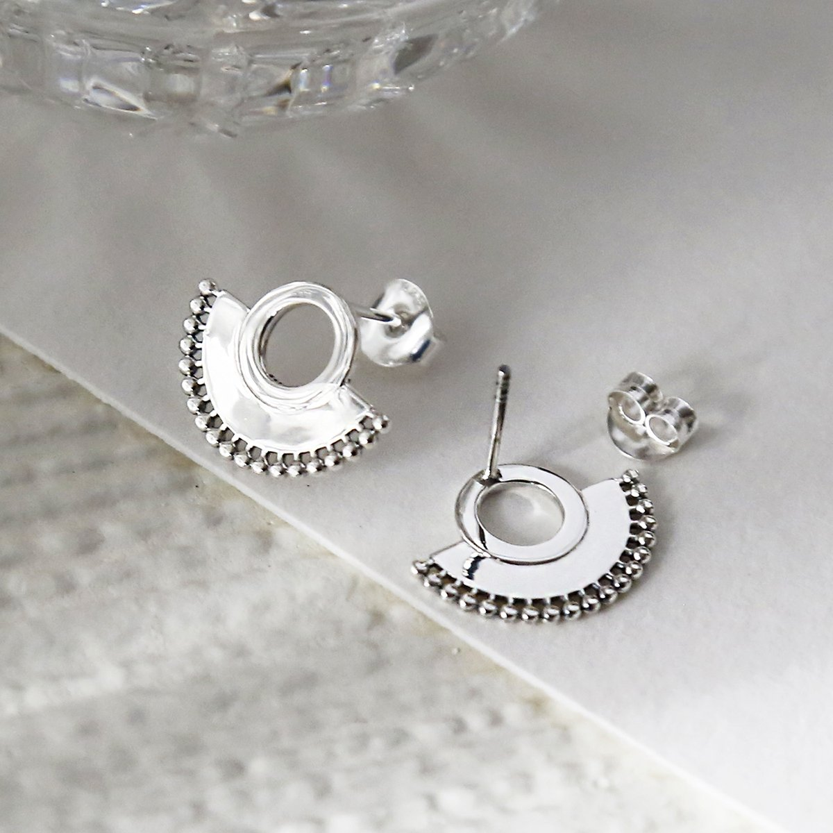 Sterling silver art deco sunburst stud earrings close up on great background showing front and back detail