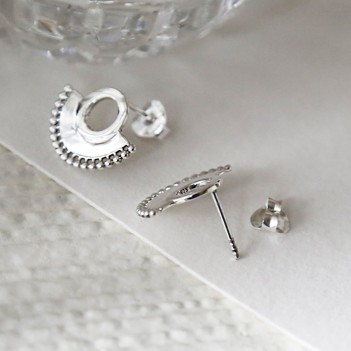 Sterling silver art deco sunburst stud earrings close up on great background showing front and top