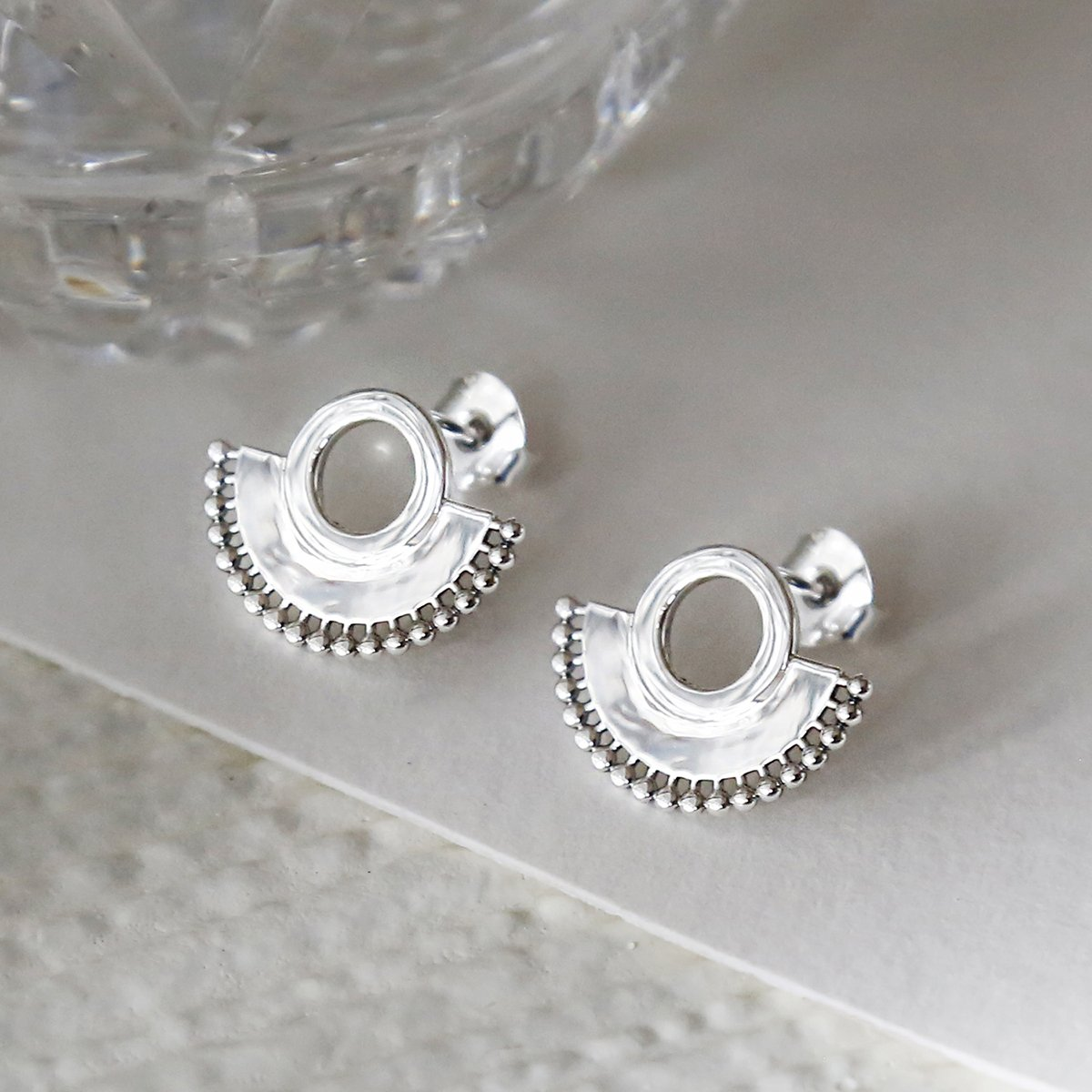 Sterling silver art deco sunburst stud earrings close up on great background