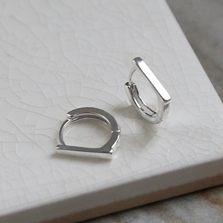 Sterling Silver Straight Edge Huggies on white background showing front and side.
