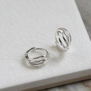 Polished sterling silver braided huggies/ hinged hoop earrings on white background showing front and side.