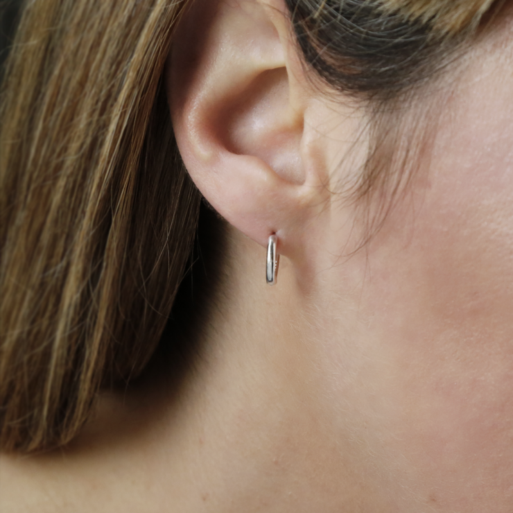 Sterling Silver Small Huggies on blonde woman's ear