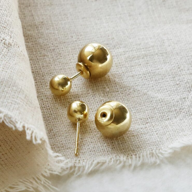 Gold Plated Venus Stud Earrings with a Cotton Background
