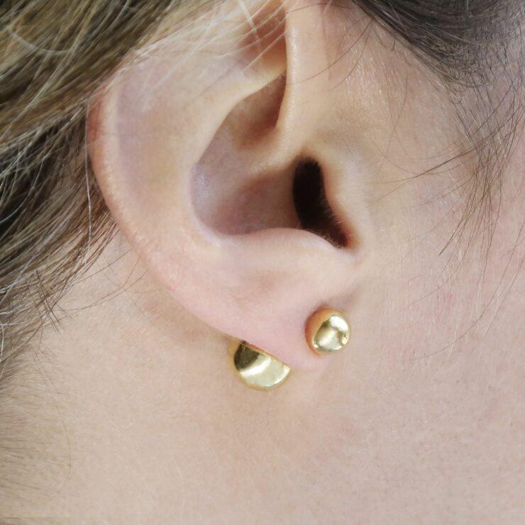 Gold Plated Venus Stud Earrings on a model