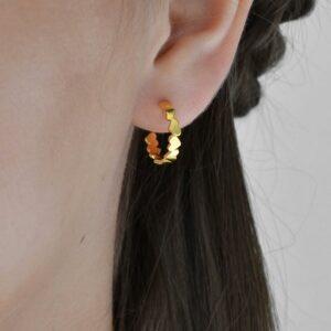 Gold Plated Love hoops on brunette model