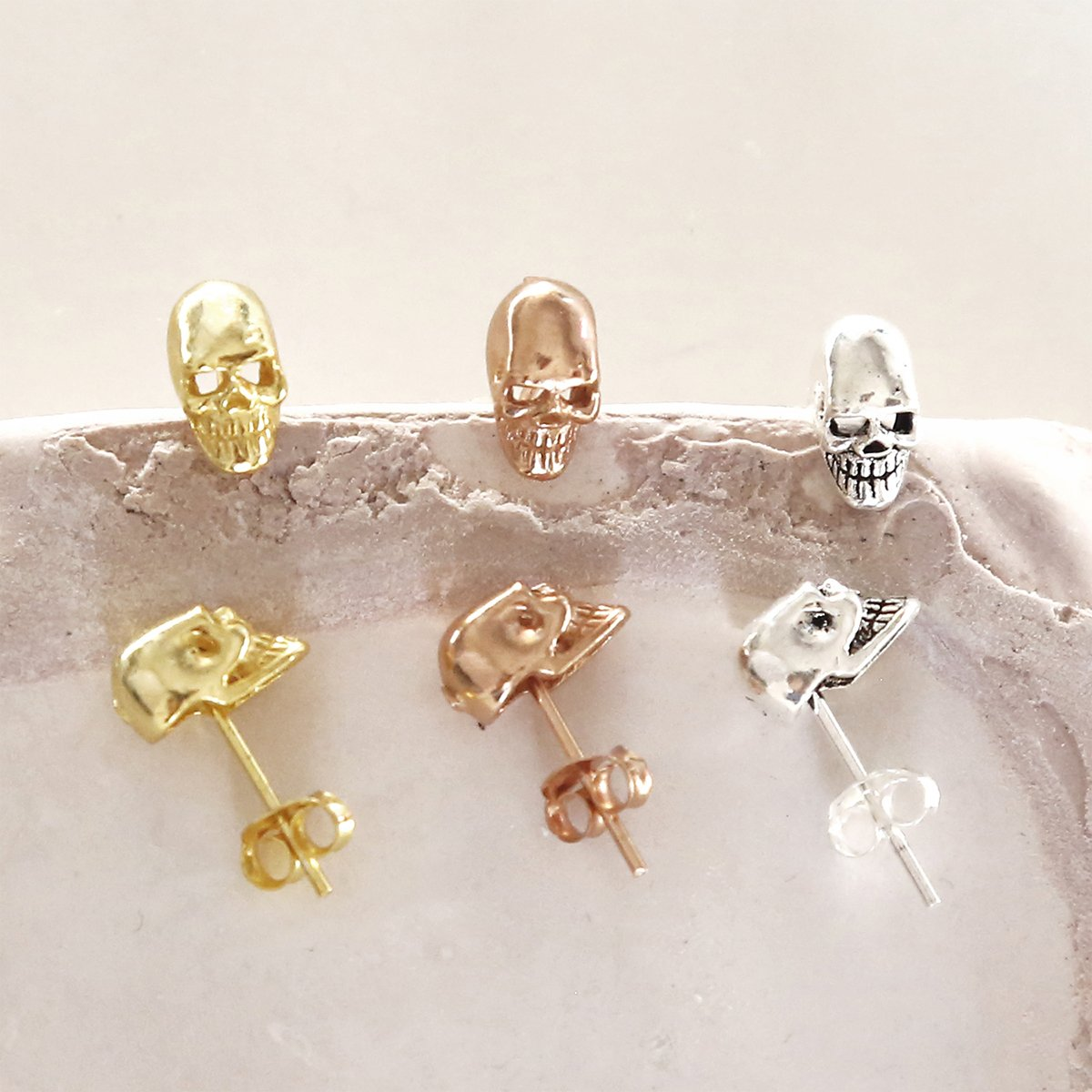 sterling silver mini skull studs showing gold silver rose gold