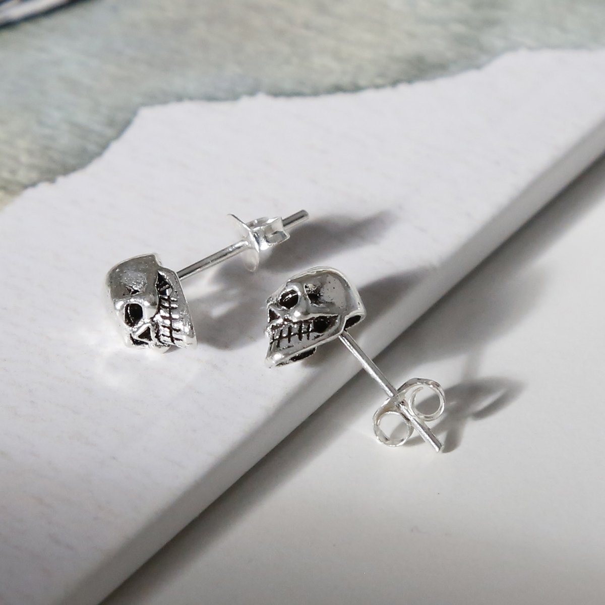 sterling silver mini skull studs showing facial detail