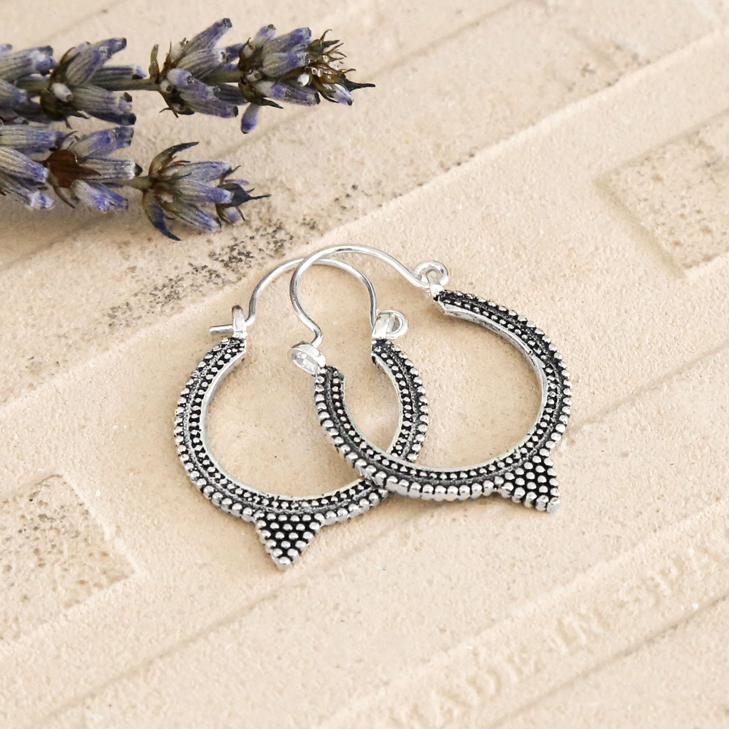 Silver Hooops with intricate Circle Oxidised Detail on a terracotta tile with Dried Lavender