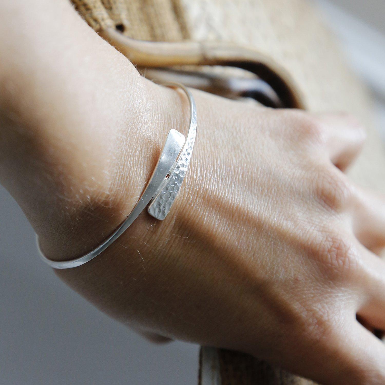 Sterling silver hidden heart bangle on model